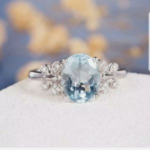**New silver toned sky blue cubic Zirconia ring